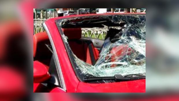 Сбитая женщина влетела в салон BMW
