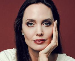 Анджелина Джоли в красном платье блистала на съемках на крыше отеля в Париже