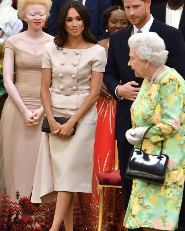 Королева и Меган