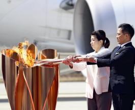 Олимпийский огонь прибыл в Японию: торжество сократили до простой формальности