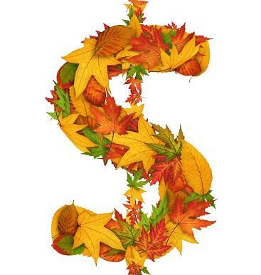 знак доллара из осенних листьев - желтых и красных