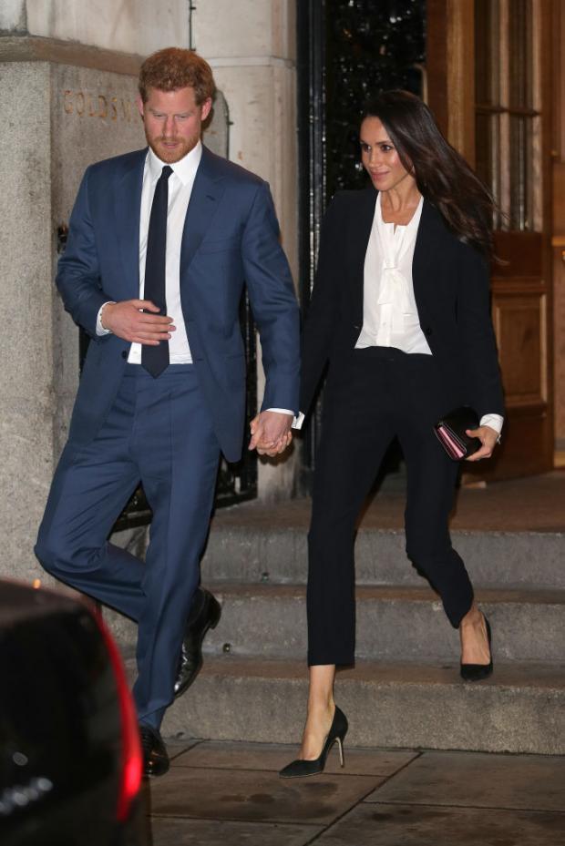 Гарри и Меган выходят под руку