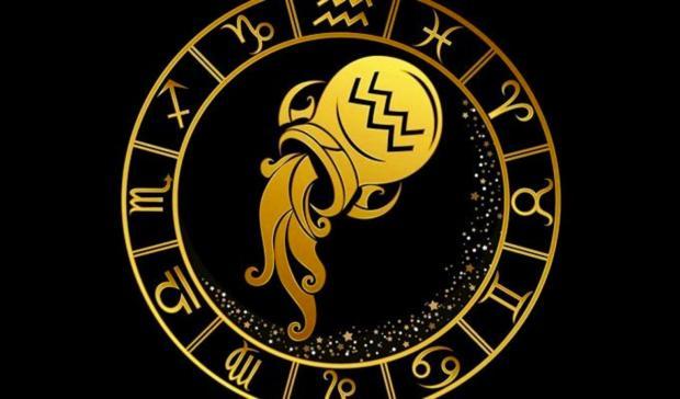 знак Зодиака Водолей золотой на черном фоне