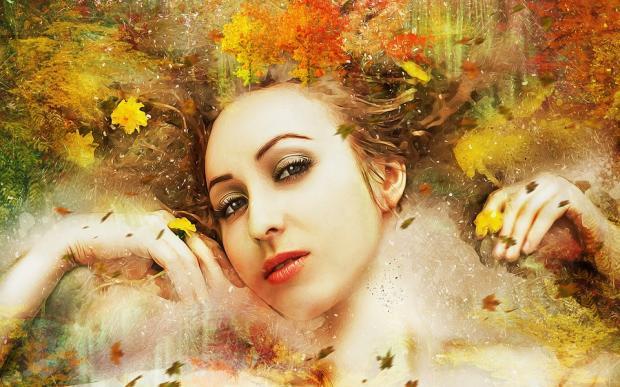 красивая девушка с вплетенным в волосы осенним пейзажем