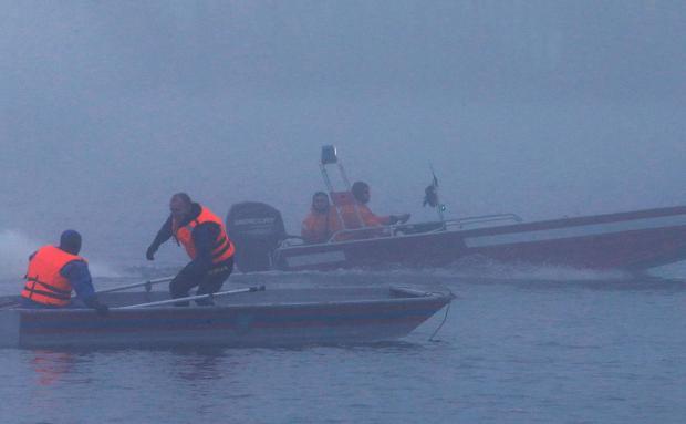 Спасатели на лодках