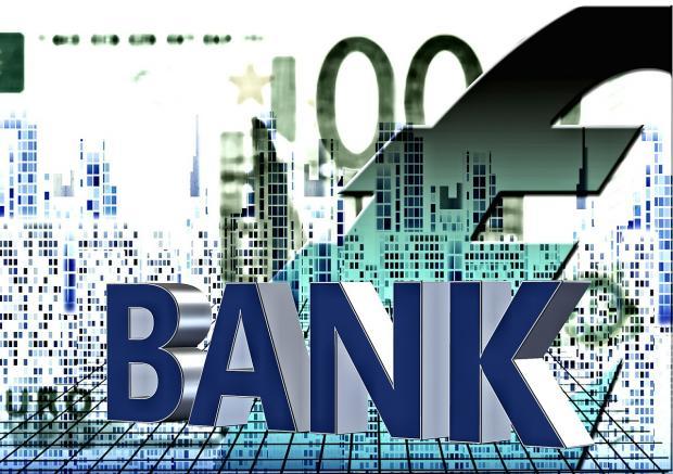 надпись Банк на фоне валют