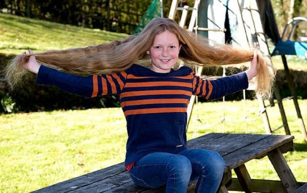 Мальчик с длинными волосами